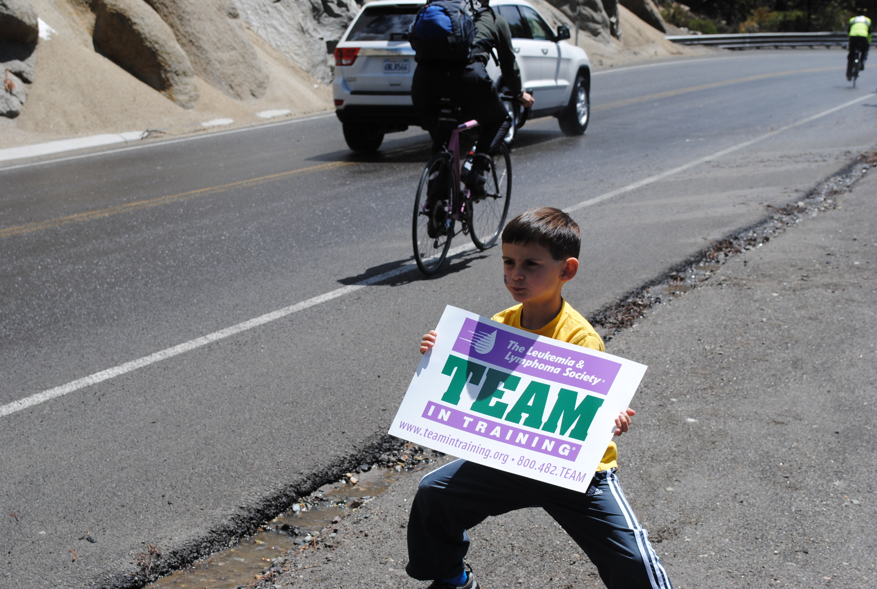 Dominic cheering for the TNT bike riders in Lake Tahoe